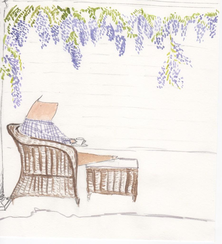 Henri sitting under wisteria
